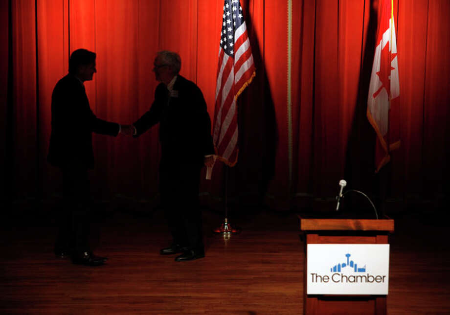Canada's ambassador to the United States, Gary Doer, left, is greeted as he makes his way to the stage Wednesday afternoon Feb. 1, 2012 at the Pearl Stable to speak during a Greater San Antonio Chamber of Commerce luncheon. Photo: William Luther / © 2012 SAN ANTONIO EXPRESS-NEWS