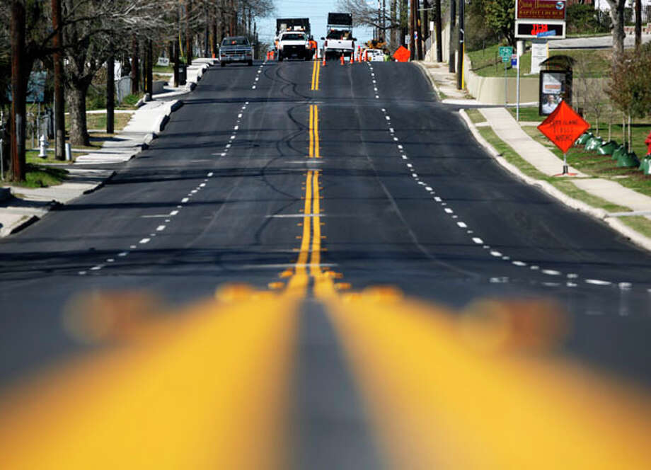 A newly refinished Martin Luther King Drive is seen Wednesday morning Jan.11, 2012 near the intersection of Clark Avenue as city workers paint stripes on the street. Photo: WILLIAM LUTHER, William Luther / 2012 SAN ANTONIO EXPRESS-NEWS
