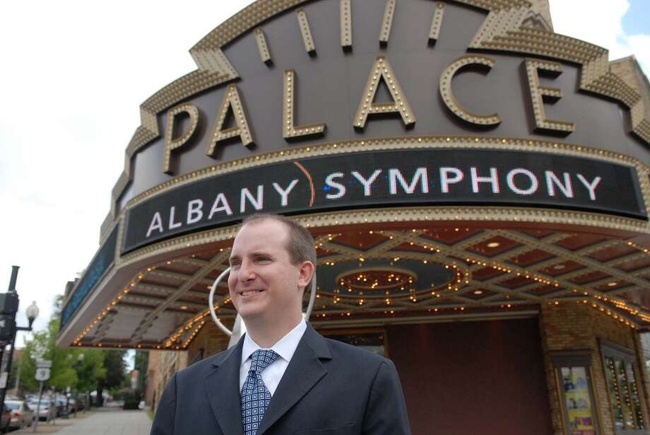 Brian Ritter, new executive dircetor of Albany Symphony Orchestra, poses outside the Palace Theater in Albany, NY on Monday, Aug. 24, 2009.  (Paul Buckowski / Times Union) (ALBANY TIMES UNION)