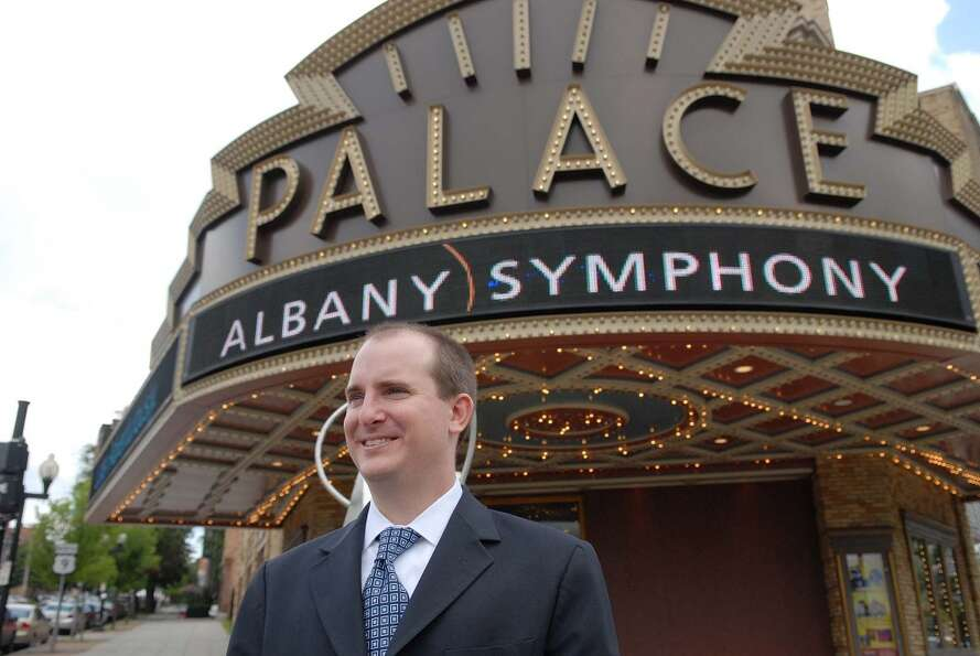 Brian Ritter, new executive dircetor of Albany Symphony Orchestra, poses outside the Palace Theater