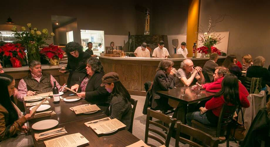 Diners enjoy dinner at Vesta. (Special to the Chronicle)