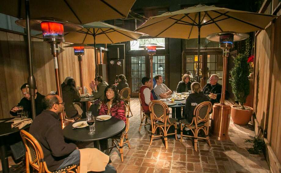 Diners enjoy dinner on the back patio at Vesta. (Special to the Chronicle)