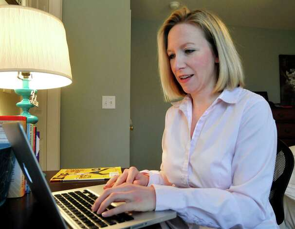 Patty Lennon works on business involving her multimedia company, Mom Gets a Life, in Danbury Thursday, Dec. 27, 2012. Photo: Michael Duffy / The News-Times