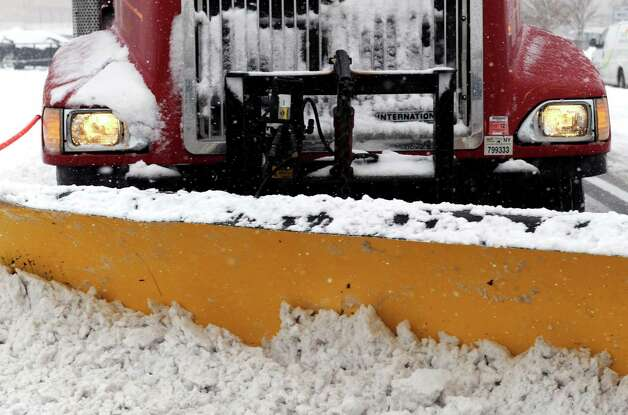 A plow works at clearing the Northway Shopping Center parking lots of snow in Colonie, N.Y., Thursday Dec. 27 2012. (Michael P. Farrell/Times Union) Photo: Michael P. Farrell