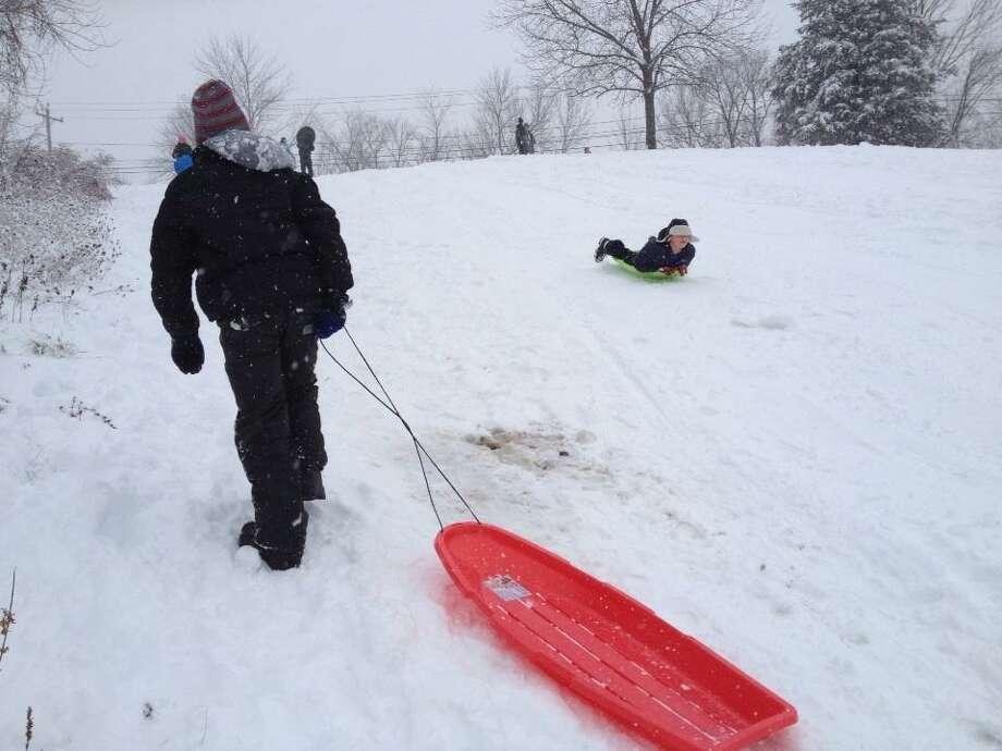 Children on school break sled at the Tawasentha Park Hill in Guilderland on Thursday, Dec. 27, 2012. (Lori Van Buren/Times Union)
