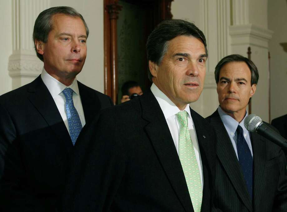 Gov. Rick Perry (center), Lt. Gov. David Dewhurst (left) and House Speaker Joe Straus  called for a moratorium on grants issued by the Cancer Research and Prevention Institute of Texas after a probe was  opened. Photo: File Phtoto, Associated Press / AP