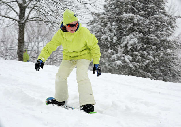 Bethy Behuniak, 12, of Slingerlands snowboards on the hill at the Tawasentha Park Winter Recreation Area during the Capital Region's first snow storm of the season on Thursday Dec. 27, 2012 in Guilderland, N.Y. (Lori Van Buren / Times Union) Photo: Lori Van Buren