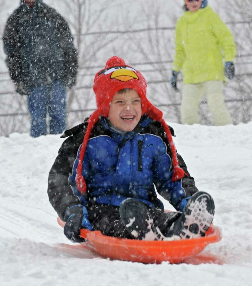 Mason Smolen, 6, of Guilderland wears his Angry Birds hat while enjoying sledding on the hill at the Tawasentha Park Winter Recreation Area during the Capital Region's first snow storm of the season on Thursday Dec. 27, 2012 in Guilderland, N.Y. (Lori Van Buren / Times Union) Photo: Lori Van Buren