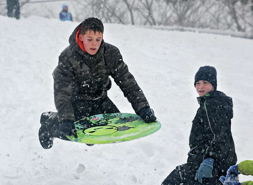 Jeff Jensen, 11, of Altamont gets some air on a jump as he enjoys sledding on the hill at the Tawase