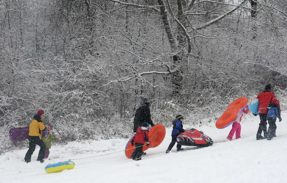 Kids of all ages enjoy sledding on the hill at the Tawasentha Park Winter Recreation Area during the