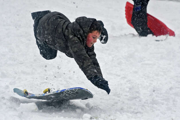 Jeff Jensen, 11, of Altamont gets some air on a jump as he enjoys sledding on the hill at the Tawasentha Park Winter Recreation Area during the Capital Region's first snow storm of the season on Thursday Dec. 27, 2012 in Guilderland, N.Y. (Lori Van Buren / Times Union) Photo: Lori Van Buren