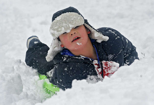 Cooper Borman of Austin Texas enjoys sledding on the hill at the Tawasentha Park Winter Recreation Area during the Capital Region's first snow storm of the season on Thursday Dec. 27, 2012 in Guilderland, N.Y. Cooper was in Guilderland visiting his grandparents. (Lori Van Buren / Times Union) Photo: Lori Van Buren