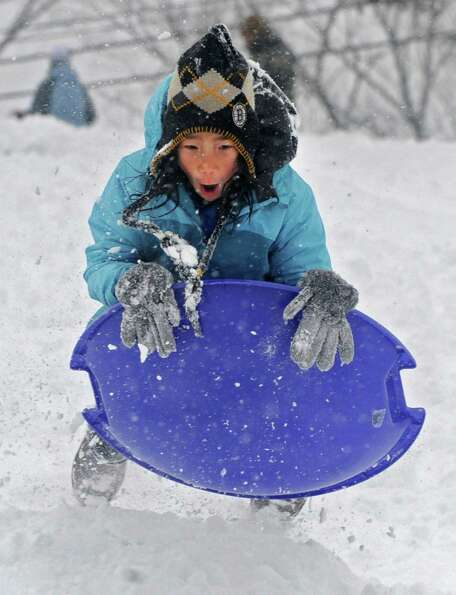 Kyra Donohue, 9, of Guilderland gets some air on a jump as she enjoys sledding on the hill at the Ta