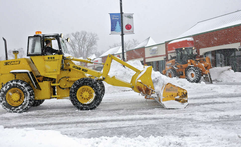 Plows clear the parking lot in the Price Chopper Plaza during the Capital Region's first snow storm