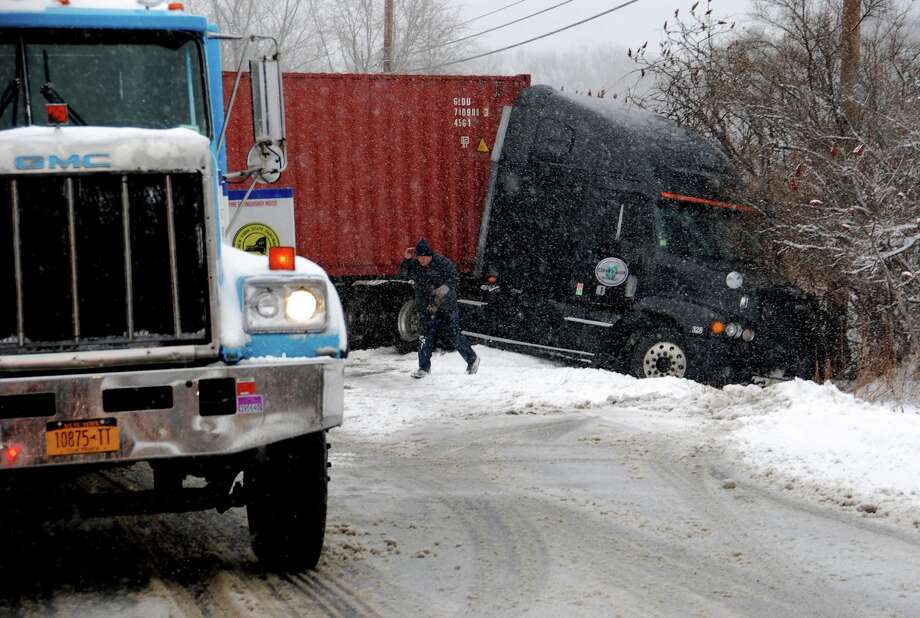 A tractor trailer jack-knifed on Route 144 in Selkirk at noon Thursday, Dec. 28, 2012. (Tom Heffernan Sr.  / Special to the Times Union) Photo: Picasa