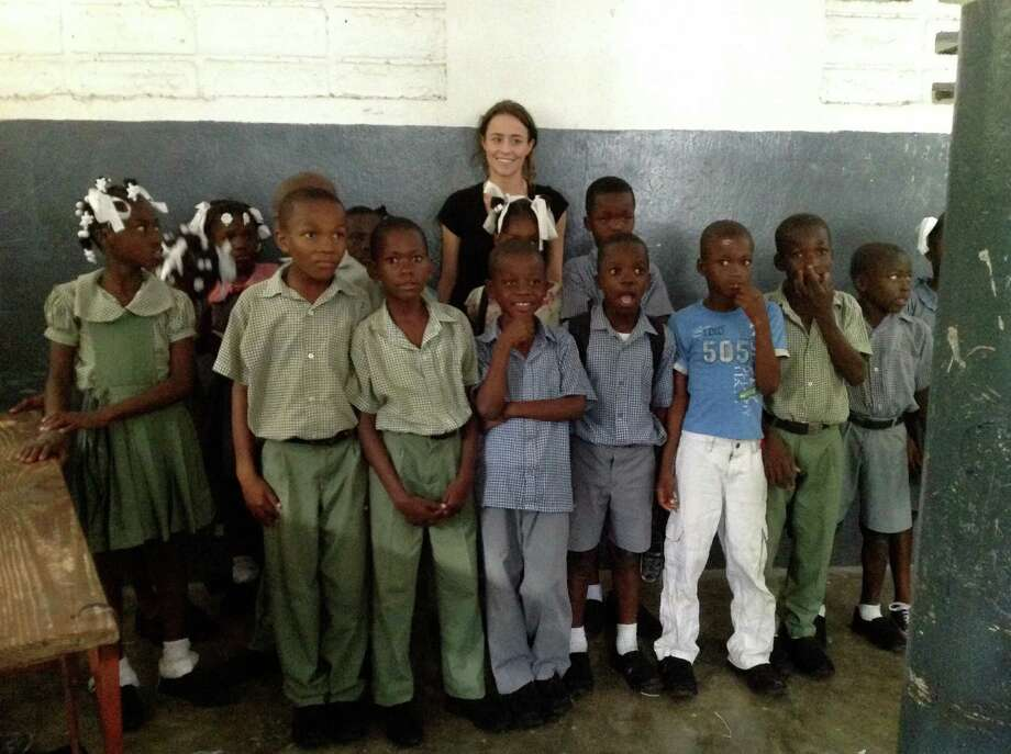 Kimberly Hogan, 27, director of the Wellspring Trust, with a class who just received all new shoes made by soles4souls at the Prophete's school in Fond Parisien, Haiti. Photo: Contributed