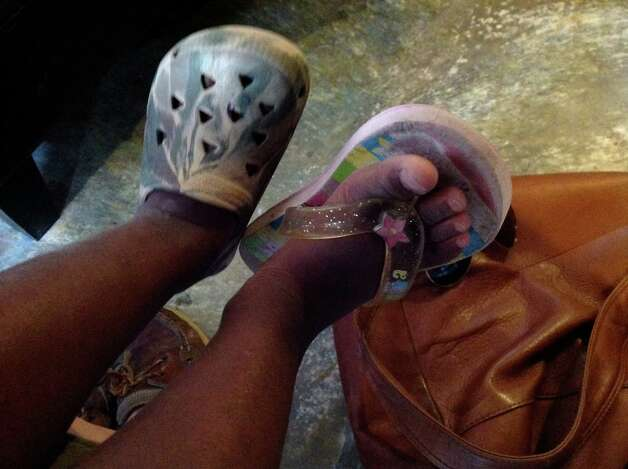 Many of the children in Haiti are forced to wear two different shoes because of the lack of funds in the country. Photo: Contributed