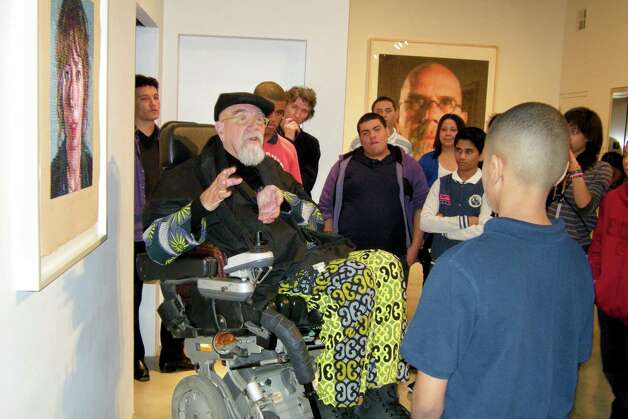 Artist Chuck Close, seated in his customized wheel chair, talks about overcoming obstacles with students from Bridgeport's Roosevelt School. Behind Close, photo left, is Japanese flute player Kojiro Umezaki. Also standing behind Close, with hand of chin, is the renowned ballet dancer and teacher Damian Woetzel. Photo: Phyllis A.S. Boros/Staff Photo