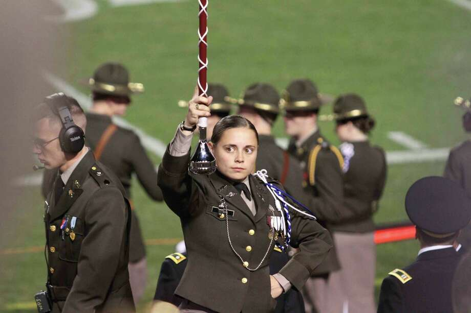 Alamo Heights High School graduate Heather Ortega is only the second-ever woman to serve as drum major for the Texas A&M University band. Photo: Mary Candee / For North Central / Dulce Design Photography