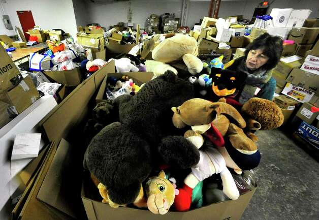 Volunteers, including Terry Ritchie, sort donated stuffed animals in a Simms Lane warehouse in Newtown Thursday, Dec. 27, 2012. Photo: Michael Duffy