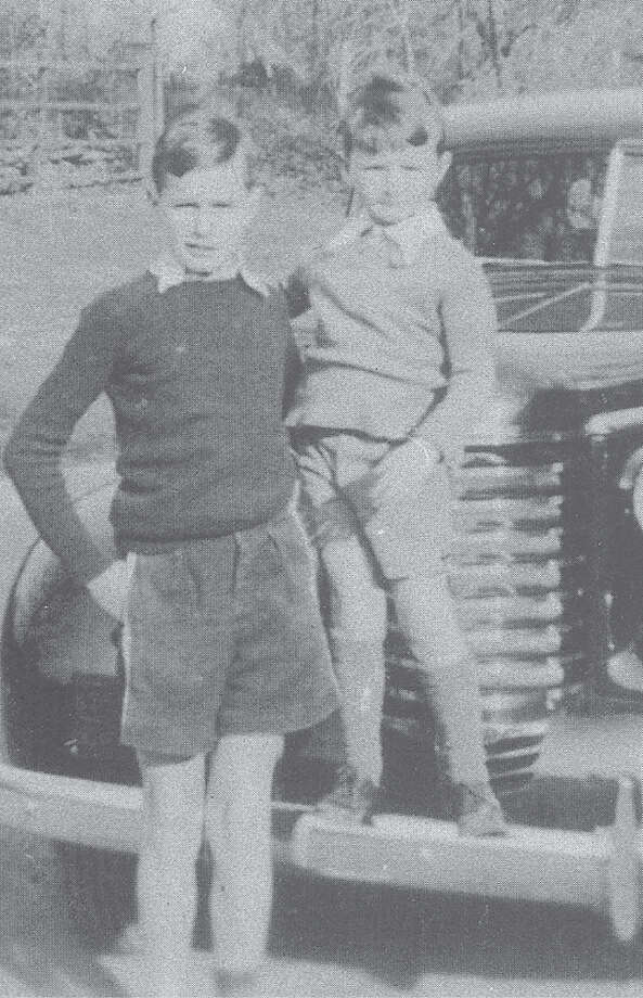 Contributed by Prescott Bush Jr. for  Greenwich: An Illustrated History  George H.W. Bush and his younger brother, John, pose for a photo at their Grove Lane home in the late 1930s, well before the elder Bush became president of the United States. George was 13 and John 6 at the time of the photo. Photo: Greenwich Time / Greenwich Time