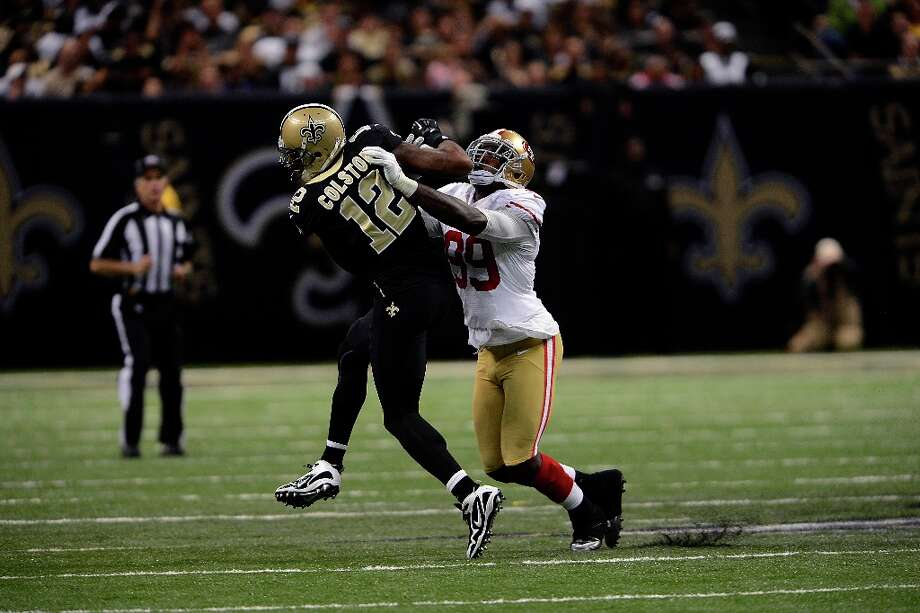 San Francisco 49ers outside linebacker Aldon Smith (99) breaks up a pass intended for New Orleans Saints wide receiver Marques Colston (12) in the second half of an NFL football game at the Louisiana Superdome in New Orleans, Sunday, Nov. 25, 2012. Photo: Bill Feig, Associated Press / FR44286 AP
