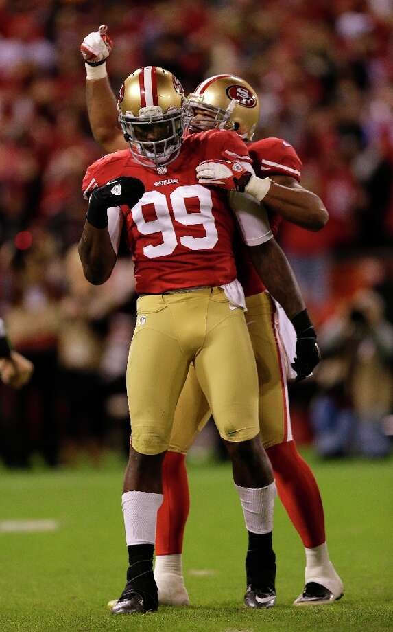 San Francisco 49ers linebacker Aldon Smith (99) is congratulated by linebacker Ahmad Brooks after sacking Chicago Bears quarterback Jason Campbell during the third quarter of an NFL football game in San Francisco, Monday, Nov. 19, 2012. Photo: Marcio Jose Sanchez, Associated Press / AP