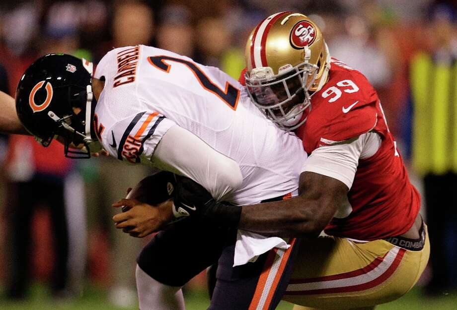 San Francisco 49ers linebacker Aldon Smith (99) sacks Chicago Bears quarterback Jason Campbell (2) during the first quarter of an NFL football game in San Francisco, Monday, Nov. 19, 2012. Photo: Tony Avelar, Associated Press / FR155217 AP