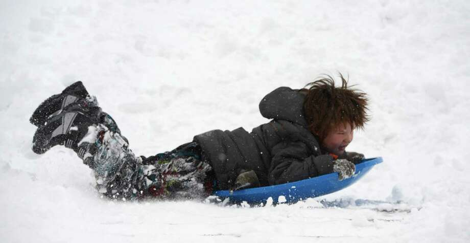 Jonathan Hepple, 6, flies down a hill in Lincoln Park in Albany, N.Y. Dec 27, 2012. (Skip Dickstein/Times Union) Photo: SKIP DICKSTEIN