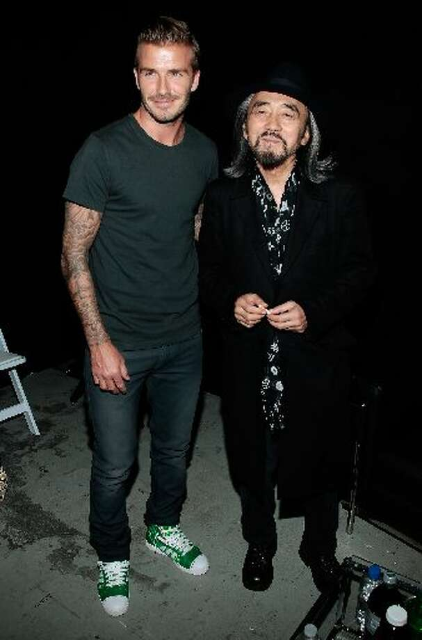 Professional soccer player David Beckham (L) and fashion designer Yohji Yamamoto attend the Y-3 10th Anniversary Collection at St. John's Center on September 9, 2012 in New York City. (Photo by Joe Kohen/Getty Images for Y-3)