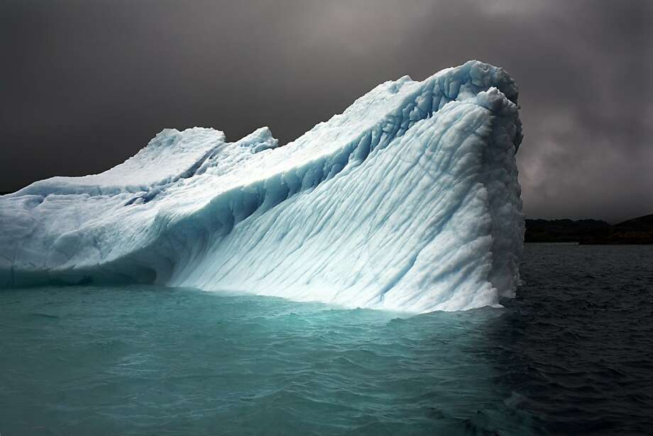 """Breaching Iceberg"" in Greenland. Photo: Camille Seaman"