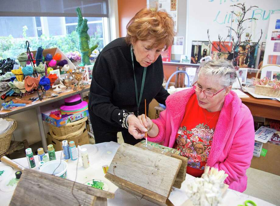 Volunteer Eileen McDowell, an artist who started the art program at Texana 15 years ago helps Shirley Villareal paint blue bonnets on a birdhouse at the Melody McDowell Arty Center , located at the Texana Center in Rosenberg, Texas. Photo: Thomas B. Shea, For The Chronicle / © 2012 Thomas B. Shea