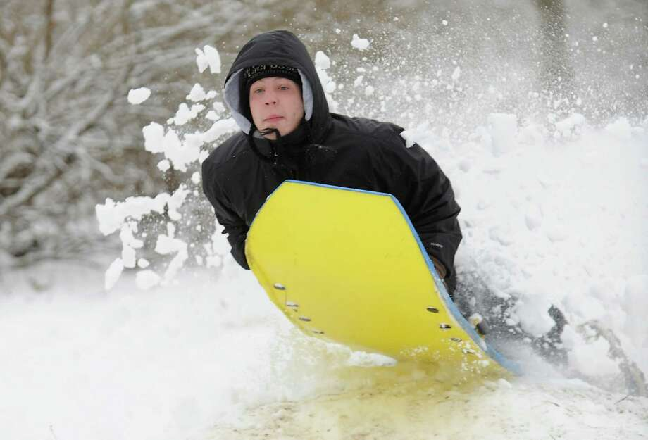 Penn State University student Andrew Bachman jumps his sled at Slab Cabin Park in State College, Pennsylvania, Thursday, December 27, 2012. Photo: Nabil K. Mark, McClatchy-Tribune News Service / Centre Daily Times