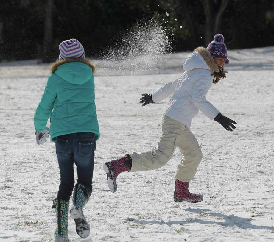 Sofia Cabellero, 10, left, and Lauren Hecker, 10, of Fort Worth, have a snowball fight in Foster Park in Fort Worth, Texas, Wednesday, Dec. 26, 2012, after winter weather covered the area with layer of snow on Christmas Day. Photo: Rodger Mallison, Associated Press / Star-Telegram