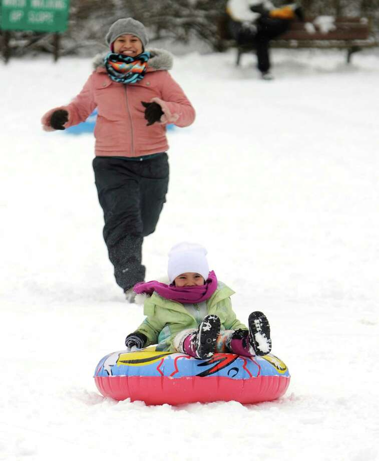 Chenoa Begaye, left, chases her daughter Dallsye Begaye, 4, down the hill at Slab Cabin Park in State College, Pennsylvania, Thursday, December 27, 2012. Photo: Nabil K. Mark, McClatchy-Tribune News Service / Centre Daily Times