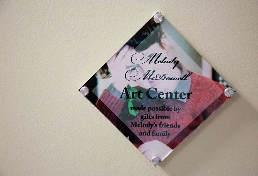 A sign with the name Melody McDowell Art Center is hun outside the wall of the Melody McDowell Arty