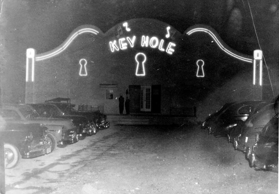 Exterior of Keyhole Club, 1619 W. Poplar, San Antonio, Texas, ca. 1950. Photograph shows an evening view of Don Albert's nightclub with neon on the facade.  Photo: UTSA SPECIAL COLLECTIONS / UTSA SPECIAL COLLECTIONS
