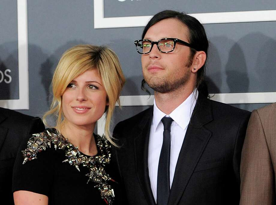 FILE - This Feb. 12, 2012 file photo shows Jessie Baylin with her husband Nathan Followill of the band Kings of Leon at the 54th annual Grammy Awards in Los Angeles. Followill and Baylin welcomed a baby girl on Wednesday, Dec. 26, 2012. (AP Photo/Chris Pizzello, File) Photo: Chris Pizzello
