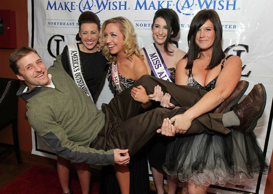 Saratoga Springs, NY - December 14, 2012 - (Photo by Joe Putrock/Special to the Times Union) - (l to r)Todd Jorgensen gets a lift from America's Outstanding Mom 2012 Nicole Palmer, America's Miss New York Kelly Slingerland, Miss Albany Amanda Daley and event organizer Casey Haight during ?New York, New York: A Night of Wishes? to benefit the Make-A-Wish Foundation at the Paddock Lounge in Saratoga Springs. Photo: Joe Putrock