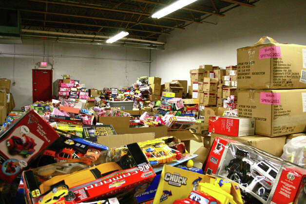 Boxes of toys awaiting sorting at a storage warehouse for goods donated in the aftermath of the Dec. 14 shooting at Sandy Hook Elementary School. Photo: Kristen V. Brown / The News-Times
