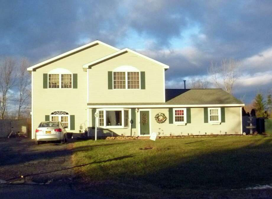 A 2,150-square-foot Colonial with four bedrooms, two bathrooms and an attached two-car garage at 24 Timber Drive is selling for $249,800. (Michael Lisi)