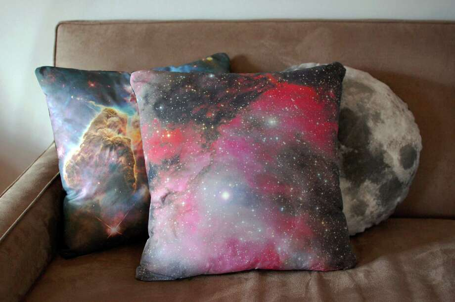 This image taken on November 6, 2012 provided by Pillars of Creation shows galaxy pillow covers (www.etsy.com/shop/pillarsofcreation) printed with images from the Hubble telescope in Portland, Oregon. (AP Photo/Pillars of Creation, Rachel Jacks) Photo: Rachel Jacks