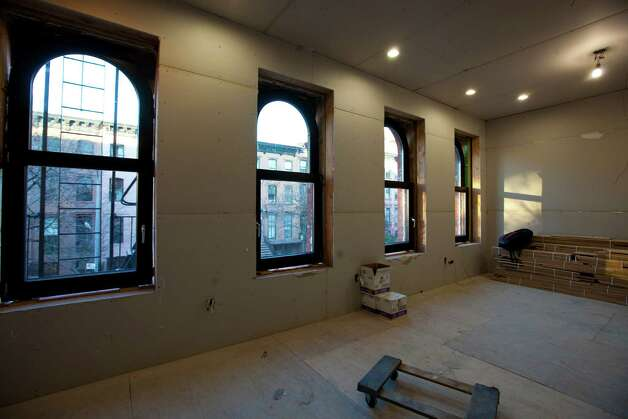 A room with triple-paned windows and six-inch-think interior walls in a building in the Prospect Heights neighborhood of the Brooklyn borough of New York, on Nov. 18, 2011. The building is being retrofitted to meet the exacting European energy-use standards known as passive house. (Uli Seit/The New York Times) Photo: ULI SEIT / NYTNS