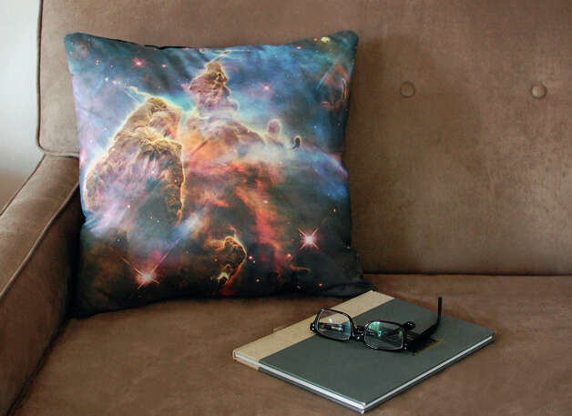 This image taken on November 6, 2012 provided by Pillars of Creation shows a galaxy pillow cover (www.etsy.com/shop/pillarsofcreation) printed with an image from the Hubble telescope in Portland, Oregon. (AP Photo/Pillars of Creation, Rachel Jacks) Photo: Rachel Jacks