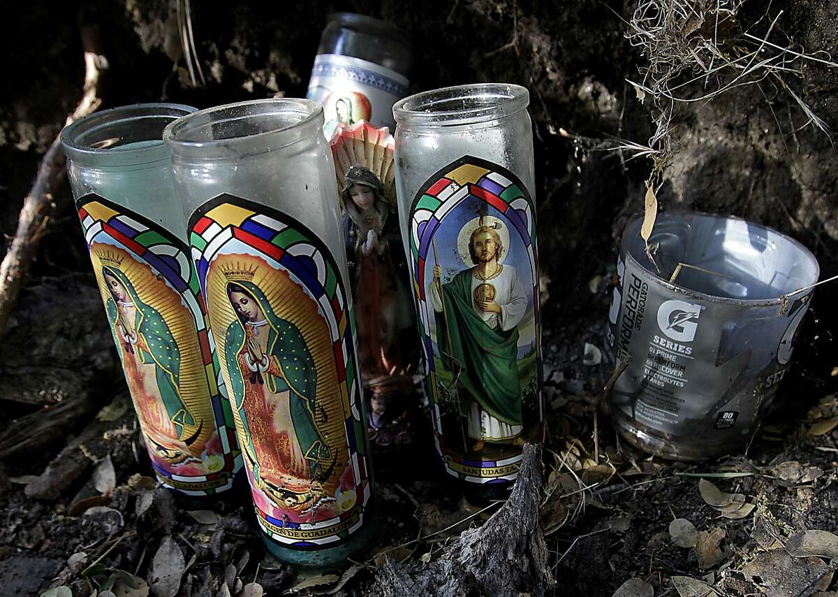 Votive candles and religious icons form a makshift shrine erected in an encampment occupied by marijuana growers near Kernville, California, August 3, 2012, just one of many such plantations sprinkled throughout public lands across the state. (Luis Sinco/Los Angeles Times/MCT)