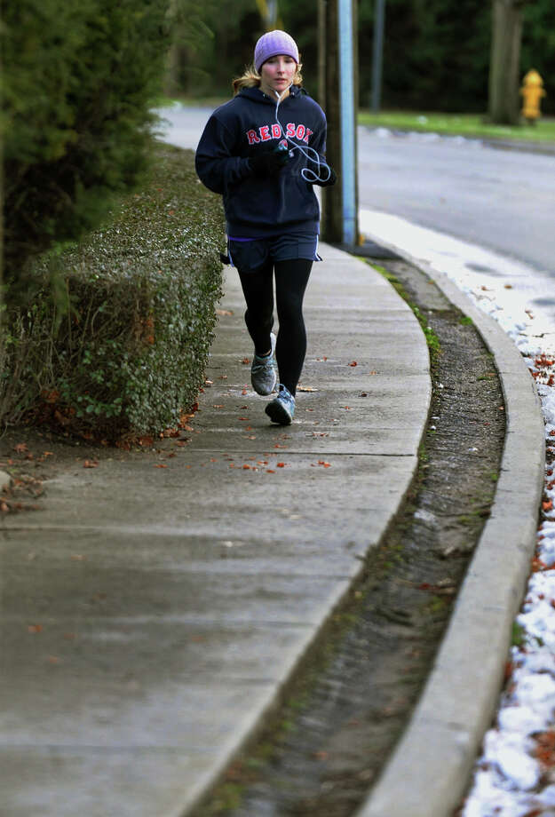Kate Palen, of Milford, jogs part of her seven mile run along Gulf Street in Milford, Conn. on Thursday December 27, 2012. Photo: Christian Abraham / Connecticut Post