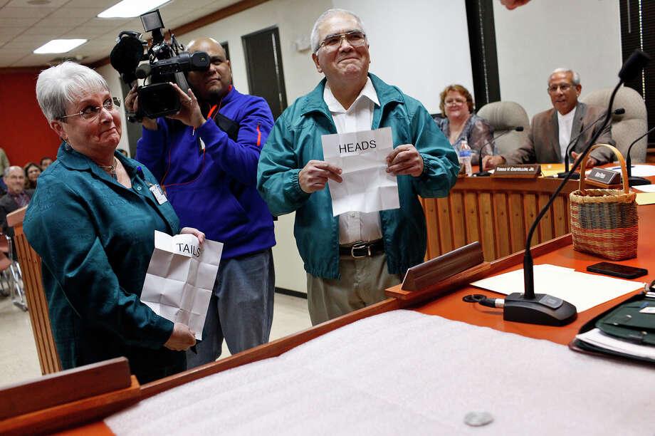 "Jeannette ""Jet"" Crabb (left) and opponent Ben Amador open the papers determining that Crabb won the coin toss. Photo: Lisa Krantz, San Antonio Express-News / © 2012 San Antonio Express-News"