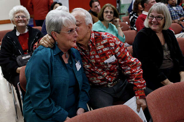 "Jeannette ""Jet"" Crabb, left, gets a kiss from her husband, Bob Crabb, as Patricia Jahns, right, watches after Crabb won the coin toss, breaking the tie for Seguin's City Council District 2 seat, during a special meeting of the Seguin City Council at Seguin City Hall on Thursday, Dec. 27, 2012. Photo: LISA KRANTZ, San Antonio Express-News / © 2012 San Antonio Express-News"