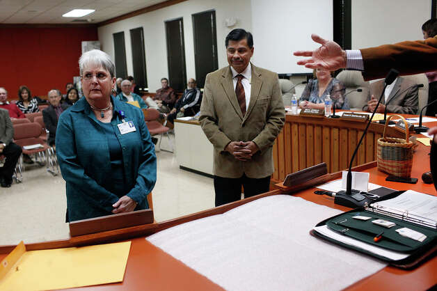 "New Seguin City Council members Jeannette ""Jet"" Crabb, left, and Ernesto Leal are welcomed to take their seats with the council by Mayor Don Keil after they were sworn in as new members during a special meeting of the Seguin City Council at Seguin City Hall on Thursday, Dec. 27, 2012. Photo: LISA KRANTZ, San Antonio Express-News / © 2012 San Antonio Express-News"