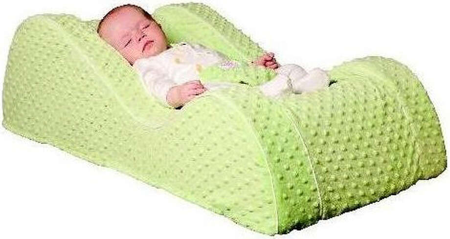 This undated image provided by the Consumer Products Safety Commission (CPSC) shows a Nap Nanny baby recliner. Four national retailers agreed to recall more than 150,000 Nap Nanny baby recliners after at least five infant deaths and dozens of reports of children nearly falling out of the recliners, the CPSC said Thursday. The recall covers Nap Nanny Generations One and Two, and the Chill model infant recliners. All were sold between 2009 and 2012. The Nap Nanny was designed to mimic the curves of a baby car seat, elevating an infant slightly to help reduce reflux, gas, stuffiness or other problems.  (AP Photo/CPSC)